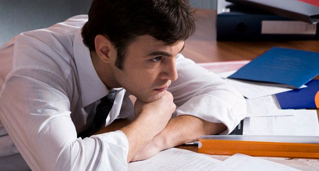 Stressed young man with paperwork