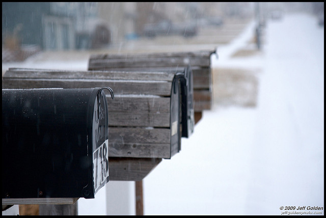 mailboxes in snow- reader mailbag