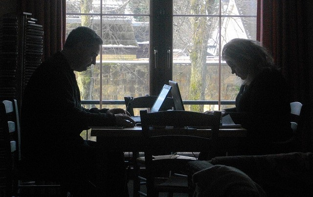 man and woman working at table