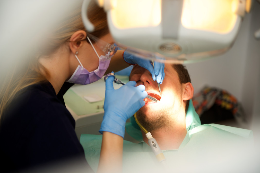 dentist and patient - how much does a filling cost