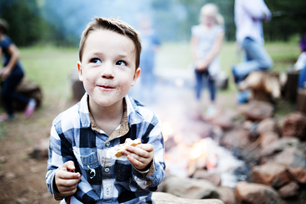 kid camping with family