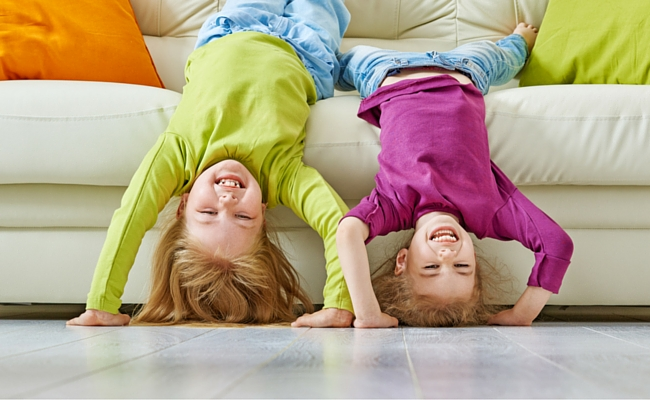 kids upside down on couch