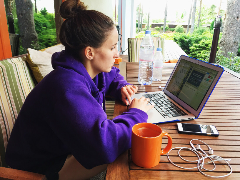 woman working remotely on porch