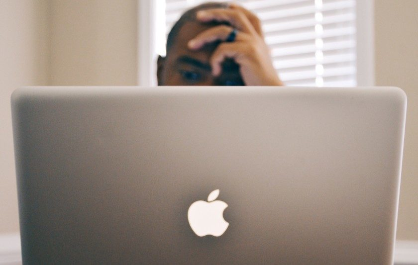 stressed man working on computer